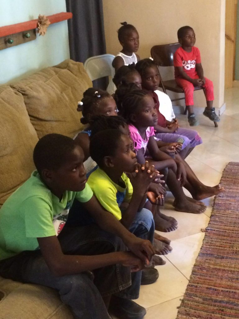Occasionally they come to listen to Bible stories and songs. I am always in awe of how many kids can fit on one couch!